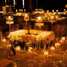 Whether you opt for a lighter colour scheme, or a scheme full of vibrant  colours, adding candles to your display will help create a romantic  atmosphere.