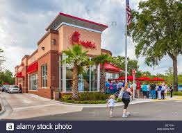 Customers line up out the door at the Chick-fil-a fast food Stock ...