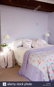 Lilac Bedroom Rose Pattered Bed Cover And Mauve Blanket On Bed With Floral
