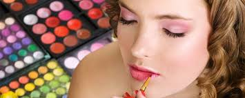 applying lip liner with palettes of makeup in the background how to bee a successful makeup artist in orange county