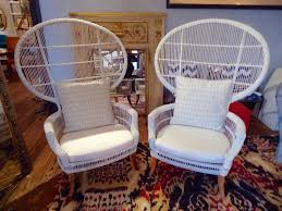 pair of dramatic large white wicker fan chairs that bring summertime indoors anytime