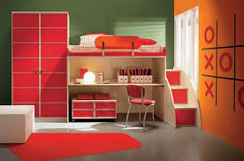 bright red accent in modern kids bedroom with polka bed cover white desk and red chair with red rug image