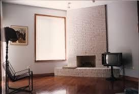 living room brick corner fireplace white painted