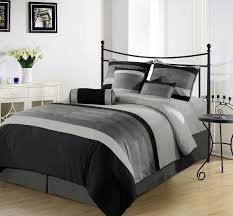 stunning image of bedroom decoration using grey plain bed valance including light grey black and white duvet covers and black iron metal headboard