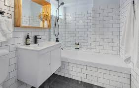 white beveled subway tile bathroom stainless steel faucet wall mount tub faucet luxury resort hotel washroom