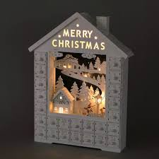 wooden advent calendar house with drawers by time concept winter ski scence with led lights