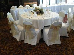 ivory chair covers with gold organza sashes traditional bow at holiday inn eagan by
