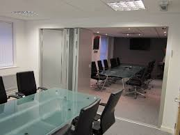 office space partitions. Multifold Folding Partitions Shown Open Between Two Office Spaces With Glass Tables Space