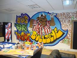office graffiti wall. Office Wall Being Painted Graffiti
