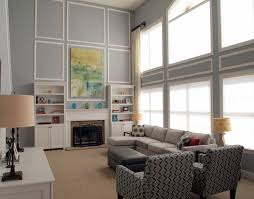 well liked gray with white striped rectangular pattern wall paneling decor with built in cabinetry system and gray fabric sectional sofas in large gray