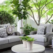 gray wicker roll arm chair with gray zebra pillows