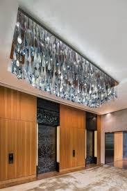 the designer wanted the vip guests to feel refreshed cool arriving at hotel from outdoor equator heat of singapore