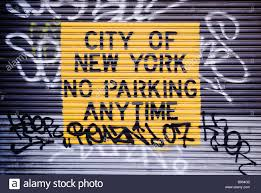 No Parking sign on a rolling garage door New York City New York ...