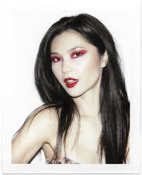 in red eye shadow and lips beauty is
