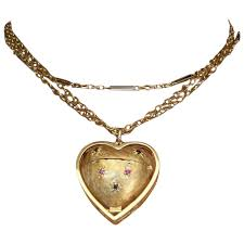 vintage large 14k yellow gold heart shaped locket pendant with rubies and sapphires