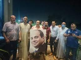 أهالى المحلة يرفعون صور الرئيس السيسي بعد تحرير الطفل زياد وعودته لأسرته -  بازار جحا