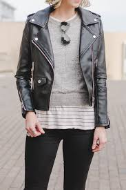 leather jacket with sweater striped tee and jeans casual leather jacket outfit idea