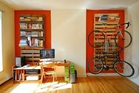 incredible pallet projects diy pallet bookshelf bike rack and more