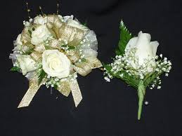 wrist corsage with white spray roses gold ribbon and accent with baby breath and matching