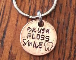 brush floss smile sted penny dental istant dentist dental hygienist graduation date penny grad gift graduation gift keychains