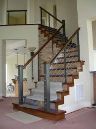 steel cable railing. Steel-framed,-stainless-steel-cable-rail-with-wood-cap Steel Cable Railing