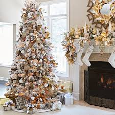 Artificial flocked Christmas tree decorated with metallic copper, silver,  gold and pink mercury glass