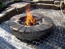 diy hosts construct fire pit and patio for cabin