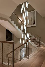 modern stairwell lighting. Elegance In Lighting. Galilee - White Candles Pendant Lighting Suspended Into A Beautiful Spiral Stairwell. Custom Modern For Today\u0027s Discerning Stairwell Pinterest
