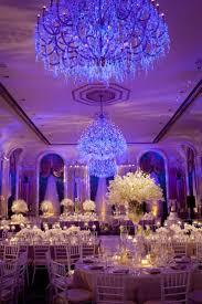 wedding reception lighting ideas. Blue-lit Reception With Bold Chandeliers Wedding Lighting Ideas