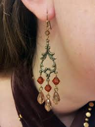 i used two 3 brass headpins to make my own earwire now they are perfect pictures above still show the old earwire