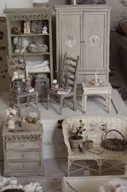 This is a sales table not a miniature flea market, but it does suggest a  nice way to display shabby chic furniture.