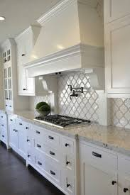 all white kitchen designs. Exellent All Dark Floors White Cabinets Granite Slabs Kitchen  To All Designs