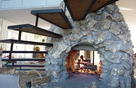 mesmerizing double sided fireplace for living room with modern fireplace featuring wicker chair with white
