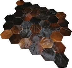 patchwork cowhide rug reddish brown