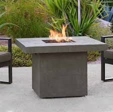 grey concrete fire pit height table