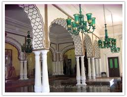 chowmahalla palace hyderabad india pillars and chandeliers in aftab mahal