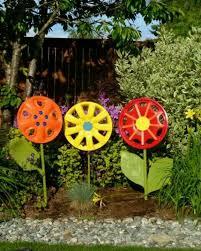 2. Rusty Vintage Wheelbarrow Flower Planters