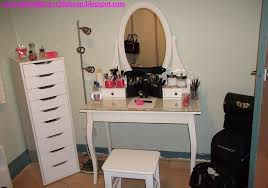 white vanity makeup table with oval mirror and chest of drawers