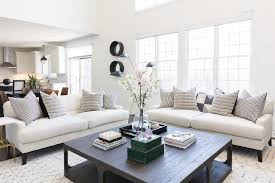 white roll back sofas with black wood coffee table
