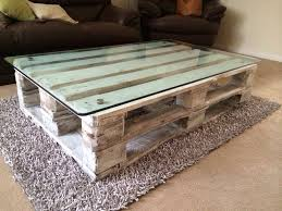 Recycled pallet coffee table with a recycled fish tank glass top.. Painted  with white