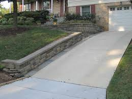 driveway retaining wall with car garage