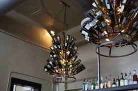 52 most fantastic playful refined wine bottle chandelier idea with round tiered iron frame beneath white