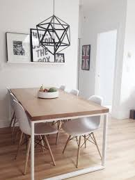 you can make the most out of a small dining area by keeping it simple then punctuating with a few pieces like art and a interesting light fixture