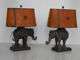 a pair of large bronze lamps by maitland smith retains original faux leather shades and