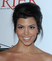 in true kardashian style kourtney pleted her look with long lashes that perfectly offset her