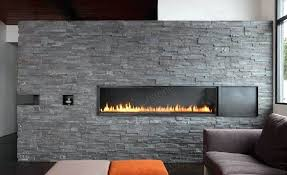 stone tile fireplace a stacked stone fireplace in a modern living room environment with a flame