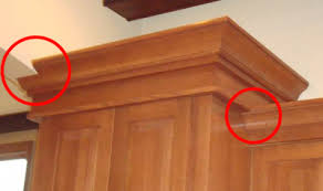 Notice how the molding has been notched during the installation to fit the  space.