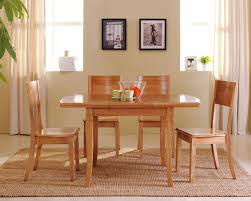 wooden dining room furniture. Furniture. Cream Cozy Dining Room Feature Rectangle Varnished Wood Table And 4 Wooden Furniture