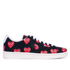 these comme des garcons play x converse sneakers are the cutest things ever