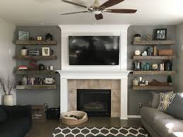 Floating Shelves For Fireplace Rustic living room Barnwood floating shelves shiplap fireplace 2